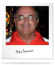 Mike Francisco with eyeglasses and wearing a red polo shirt